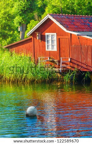 Idyllic boathouse during summer in sweden - stock photo