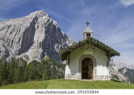Idyllic chapel in Karwendel mountains with the little Lafatscher - stock photo