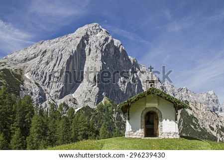 Idyllic chapel in Karwendel mountains with the little Lafatscher - stock photo