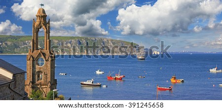 idyllic coastal landscape swanage in dorset, historic church tower and cliff view - stock photo