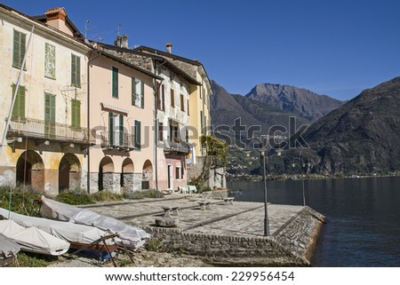 Idyllic colorful houses on the shores of Lake Como - stock photo