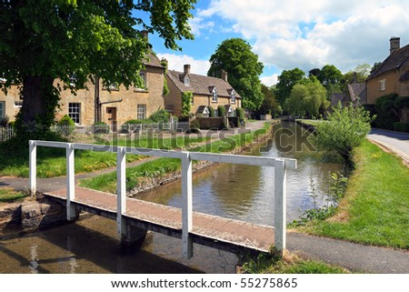 Idyllic Cotswolds village of Lower Slaughter in early summer sunshine - stock photo