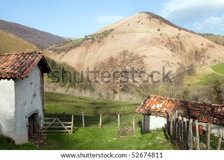 Idyllic farmhouse shed in the French pyrenees mountains against the Spanish border (Basque country) - stock photo