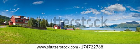 Idyllic farmland, rolling landscape and mountains in the distance. - stock photo