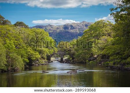Idyllic Irish Setting With An Old Bridge Over A Beautiful River - stock photo