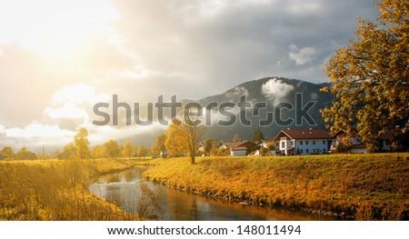 Idyllic landscape of alpine autumn scene - stock photo