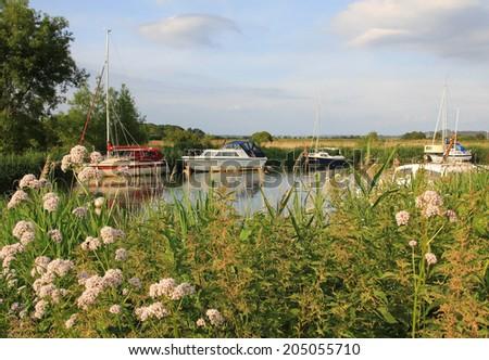idyllic river frome with sail boats, river walks wareham, dorset - stock photo
