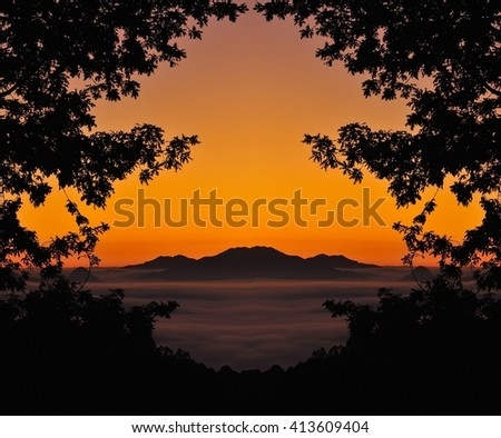 Idyllic scene on mountain silhouette at sunset - stock photo