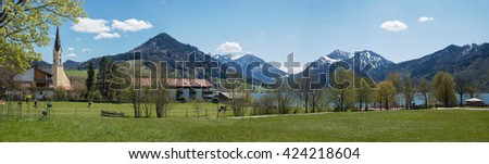 idyllic spring landscape at spa town schliersee with green pasture and mountain view