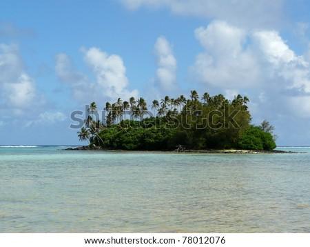 Idyllic tropical beach and palm tree covered atoll at Muri Lagoon on Rarotonga, Cook Islands - stock photo