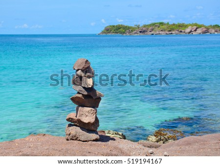 Idyllic tropical beach with the rocks in sunny day