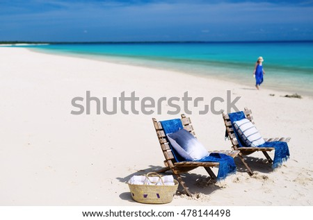 Idyllic tropical beach with white sand, turquoise ocean water and blue sky in Mozambique Africa