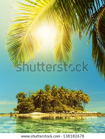 Idyllic tropical island in sunny day - stock photo