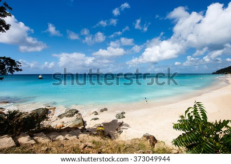 Idyllic tropical Turners beach with white sand, turquoise ocean water and blue sky at Antigua island in Caribbean - stock photo