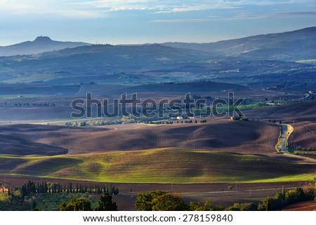 Idyllic Tuscan landscape at sunrise near Pienza,  Italy, Europe - stock photo