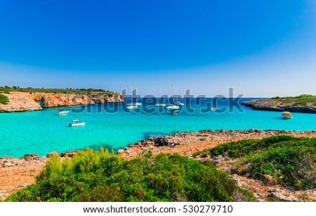 Idyllic view to the bay Cala Varques at Spain, Island Majorca, Mediterranean Sea with turquoise water and anchoring boats.
