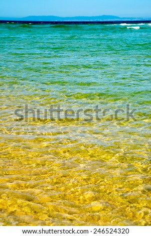 Idyllic wild beach in summertime. Atlantic Ocean, Portugal. - stock photo