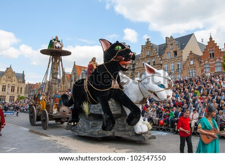 IEPER, BELGIUM - MAY 13, 2012: Giant cats statues participate in the 43th edition of the Cat Parade in Ieper, Belgium on May 13, 2012 - stock photo