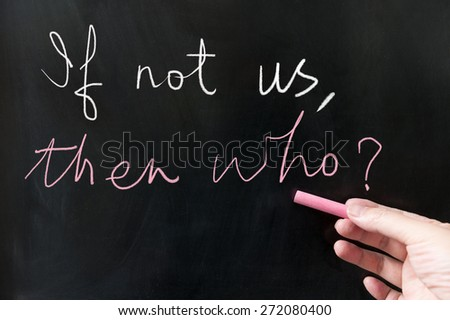 If not us then who words written on blackboard using chalk - stock photo