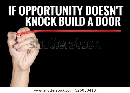 If Opportunity Doesnt Knock Build a Door word writting by men hand holding highlighter pen with line on black background - stock photo
