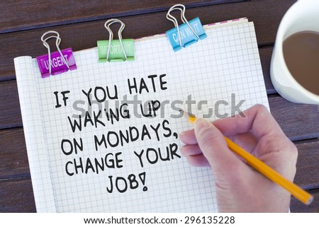 If you hate waking up on mondays change your job / Motivational phrase note hand writing on notebook - stock photo
