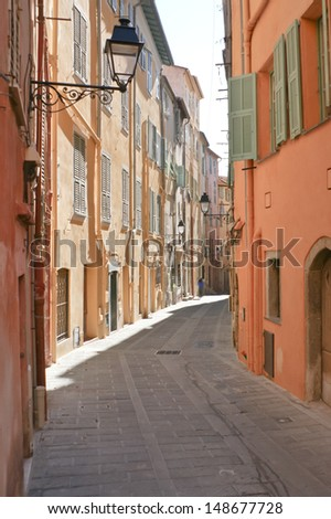 if you walk in mediterranean towns possibly you will find such narrow winding streets, like this located in town of Menton, located  near Monaco and Nice, Provence-Alpes-Cote d'Azur region, France.