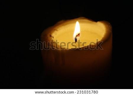 ighted candle - burning candle - stock photo