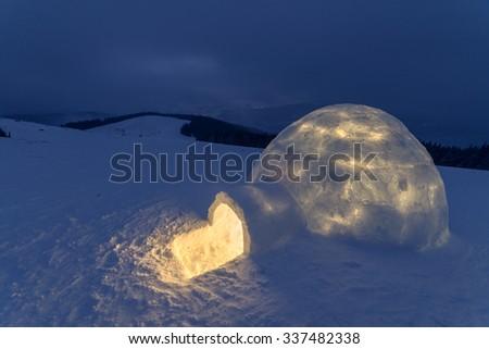 igloo in the high mountain - stock photo