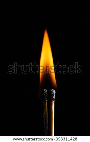 Ignited match and blown off match isolated on black - stock photo
