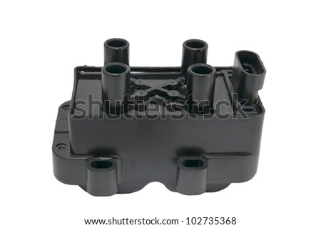 Ignition coil for the four-cylinder engine on a white background - stock photo