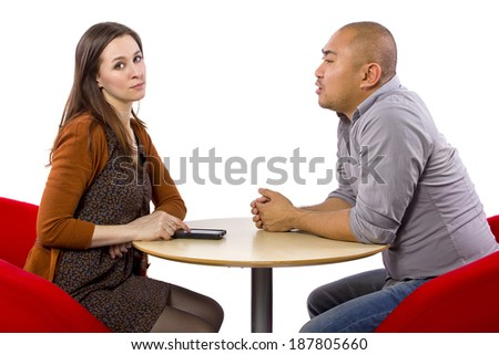 ignoring a boring date while on a cell phone - stock photo