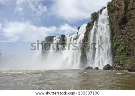 Iguassu falls (Iguazu/Iguacu), Misiones, Argentina and Parana, Brazil. Viewed from a boat. - stock photo