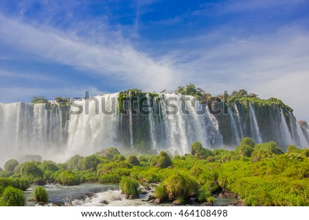 IGUAZU, BRAZIL - MAY 14, 2016: bottom view from the waterfalls, blue sky with some cluods as background
