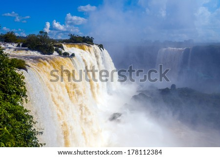 Iguazu Falls or Iguassu Falls in Brazil. Beautiful Cascade of waterfalls with jungle and cloudscape - stock photo