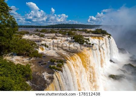 Iguazu Falls or Iguassu Falls in Brazil. Beautiful Cascade of waterfalls with jungle and cloudscape - stock photo