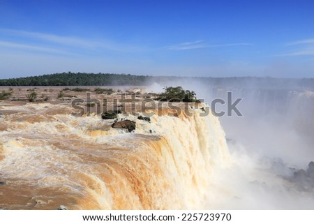 Iguazu Falls - spectacular waterfalls on Brazil and Argentina border. National park and UNESCO World Heritage Site. Garganta del Diablo seen from Brazilian side. - stock photo