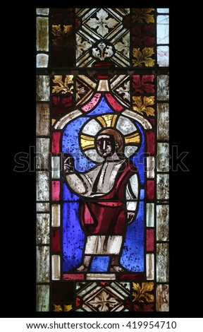 IHLINGEN, GERMANY - OCTOBER 21: Jesus Christ, stained glass window in the church of Saint James in Ihlingen, Germany on October 21, 2014. - stock photo