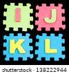 IJKL Alphabet learning blocks isolated Black - stock photo