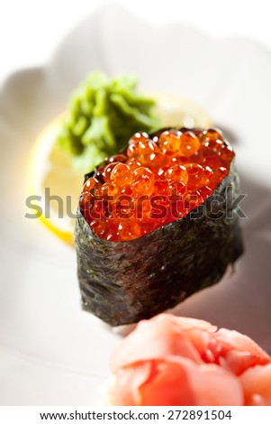 Ikura Gunkan Maki Sushi. Garnished with Ginger and Wasabi - stock photo
