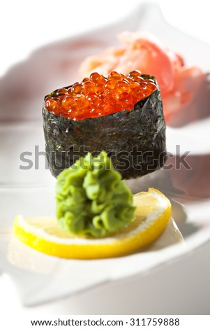 Ikura Gunkan Maki Sushi. Garnished with Ginger and Wasabi - stock photo
