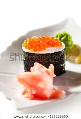 Ikura (Salmon Roe) Gunkan Maki Sushi with Cream Cheese. Garnished with Ginger and Wasabi - stock photo