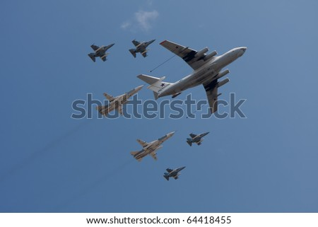 Il-78 aerial refueling tanker with two Su-24 attack aircrafts and four Yak-130 jet trainers