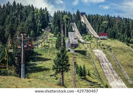 Ilidza, Bosnia and Herzegovina - August 24, 2015. Abandoned Olympic Jumps on the mountain of Igman in Ilidza. The Objects was built for Winter Olympic Games in 1984