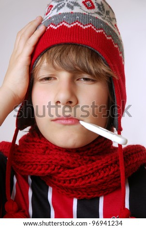 ill boy with hat and thermometer - stock photo