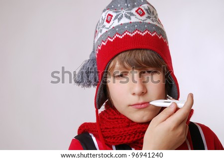 ill boy with hat and thermometer
