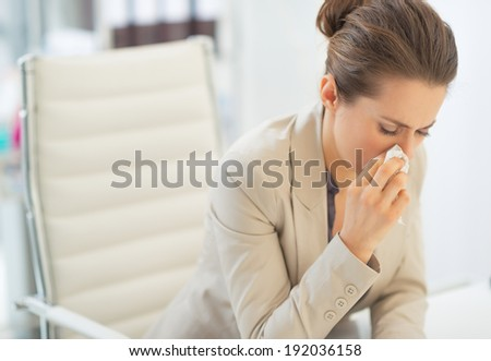 Ill business woman at work - stock photo