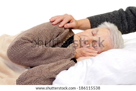 Ill elderly woman lying in the bed - stock photo