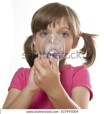 ill little girl using inhaler - respiratory problems white background - stock photo