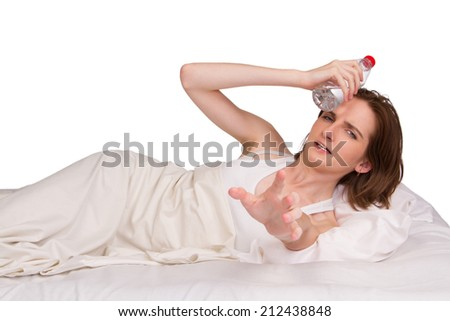 Ill woman in bed with headache - stock photo