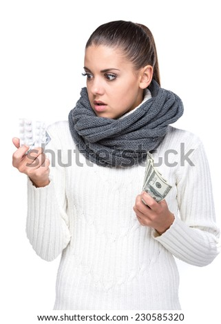 Ill woman is taking the pills and money. Expensive drugs. - stock photo